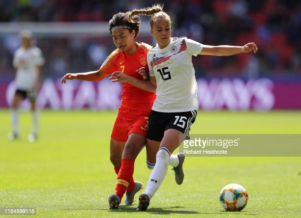 Giulia Gwinn of Germany battles for possession with Shuang Wang of China during the 2019 FIFA Women's World Cup France group B match between Germany...