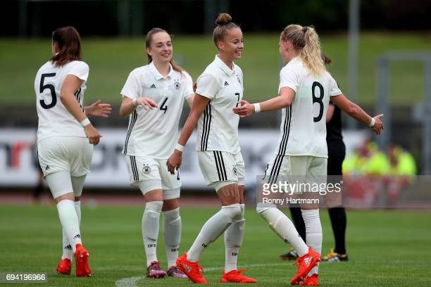 Giulia Gwinn of Germany celebrates after scoring her team's opening goal with Tanja Pawollek Sophia Kleinherne and Kim Fellhauer of Germany during...