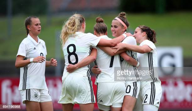 Giulia Gwinn of Germany celebrates after scoring her team's opening goal with Klara Buehl Kim Fellhauer Laura Freigang and Dina Orschmann of Germany...