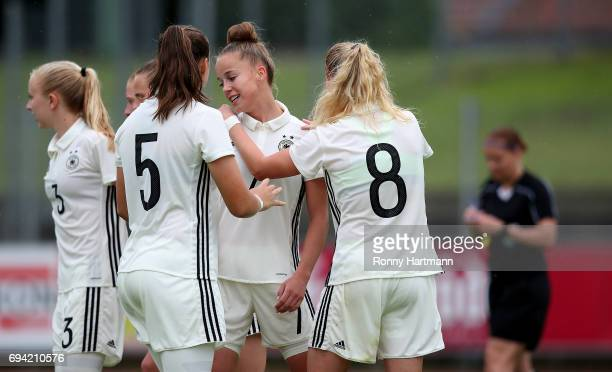 Giulia Gwinn of Germany celebrates after scoring her team's opening goal with Caroline Siems Tanja Pawollek and Kim Fellhauer of Germany during the...