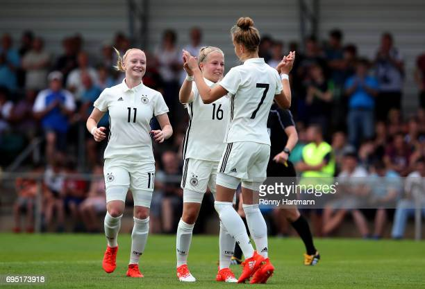 Giulia Gwinn of Germany celebrates after scoring her team's sixth goal with Luca Maria Graf and Anna Gerhardt of Germany during the U19 women's elite...