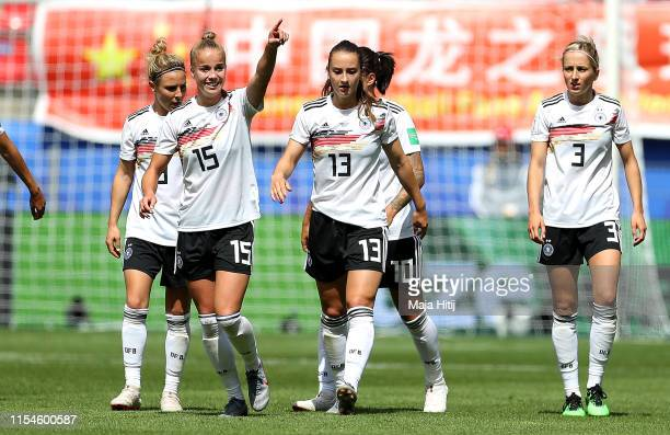 Giulia Gwinn of Germany celebrates with teammates after scoring her team's first goal during the 2019 FIFA Women's World Cup France group B match...