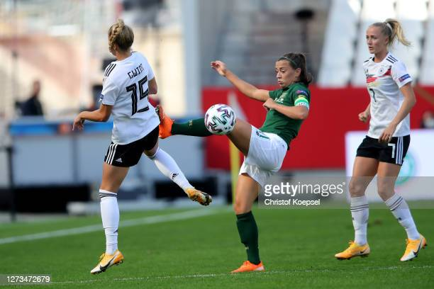 Giulia Gwinn of Germany challenges Katie McCabe of Ireland during the UEFA Women's EURO 2022 Qualifier match between Germany and Ireland at Stadion...