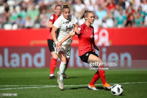 Giulia Gwinn of Germany challenges Laura Wienroither of Austria during the International friendly match between Germany Women and Austria Women at...