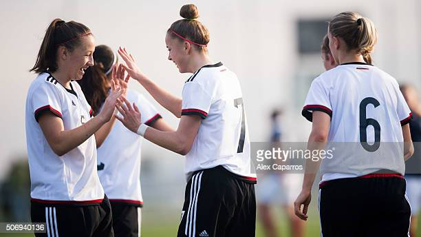 Giulia Gwinn of Germany is congratulated by her teammate Tanja Pawollek after scoring the opening goal during the U17 girl's international friendly...