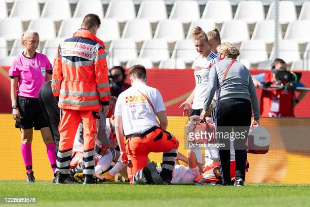 Giulia Gwinn of Germany is injured during the UEFA Women's EURO 2022 Qualifier between Germany Women's and Ireland Women's at Stadion Essen on...