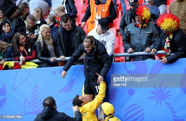 Giulia Gwinn of Germany is lifted down after seeing her family after the 2019 FIFA Women's World Cup France group B match between Germany and Spain...