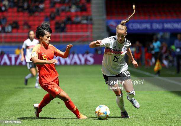 Giulia Gwinn of Germany is put under pressure by Haiyan Wu of China during the 2019 FIFA Women's World Cup France group B match between Germany and...
