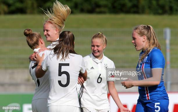 Giulia Gwinn of Germany jubilates with team mates after scoring the third goal during the U19 women's elite round match between Germany and Iceland...