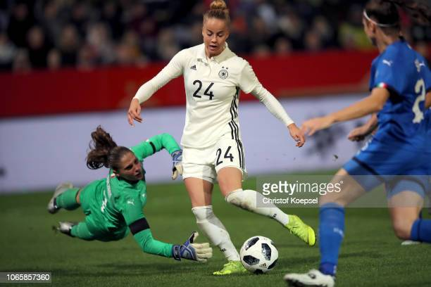 Giulia Gwinn of Germany scores the thrid goal against Laura Giuliani of Italy during the Women's International Friendly match between Germany and...
