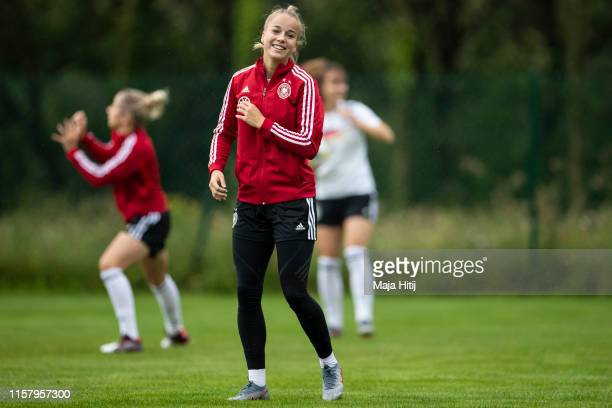 Giulia Gwinn of Germany smiles during a training on June 24 2019 in Rennes France