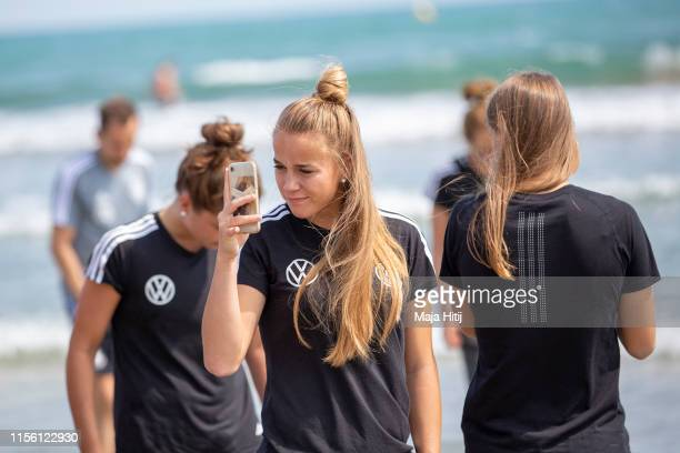 Giulia Gwinn of Germany takes pictures as team of Germany visits the beach on June 15, 2019 in La Grande-Motte, France.