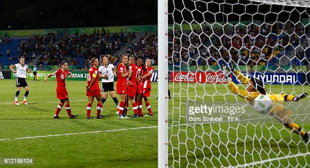 Giulia Gwinn of Germanyscores her team's first goal with a freekick during the FIFA U17 Women's World Cup Jordan Group B match between Germany and...