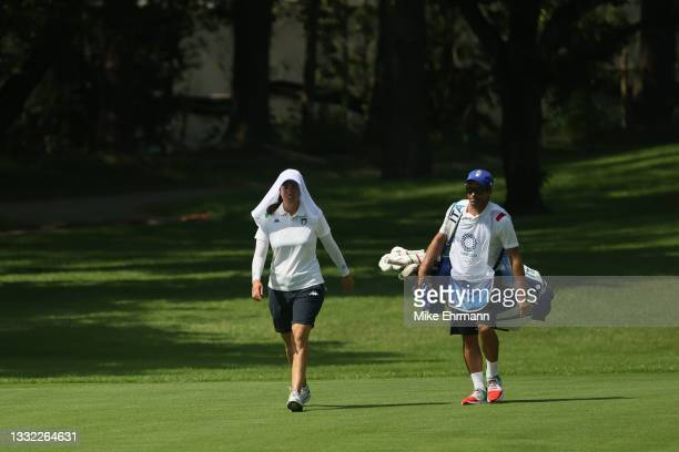 Giulia Molinaro of Team Italy walks with her caddie up the 17th hole during the first round of the Women's Individual Stroke Play on day twelve of...