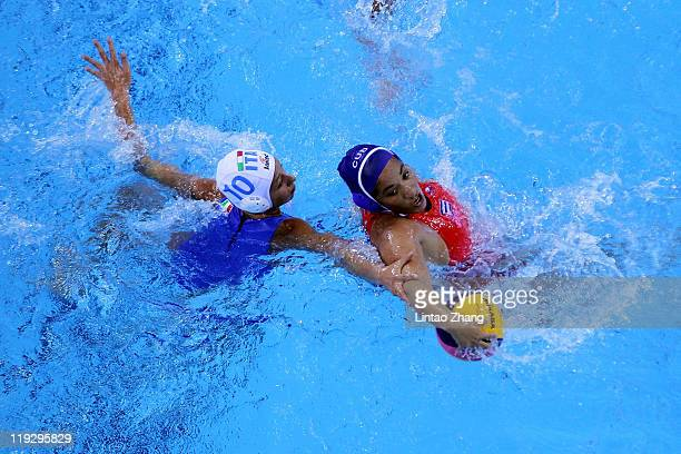 Giulia RambaldiGuidasci of italy battles for the ball with Yeliana BravoCurro of Cuba in the Women's Water Polo first preliminary round match between...