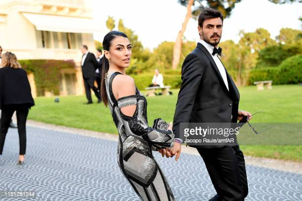 Giulia Salemi and Francesco Monte attend the amfAR Cannes Gala 2019 at Hotel du CapEdenRoc on May 23 2019 in Cap d'Antibes France