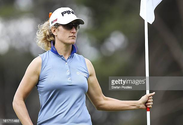 Giulia Sergas of Italy holds the flag during day two of the ISPS Handa Australian Open at Royal Canberra Golf Club on February 15 2013 in Canberra...