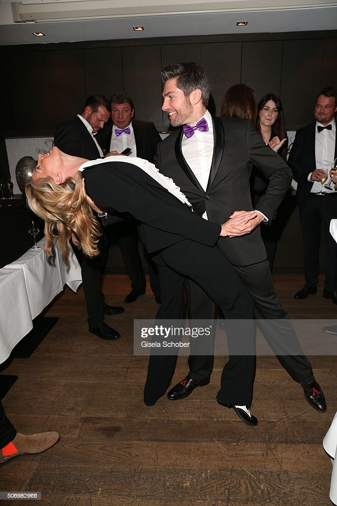 Giulia Siegel and Christian Polanc dances during the Smoking Cocktail at Kaefer Atelier on January 26, 2016 in Munich, Germany.