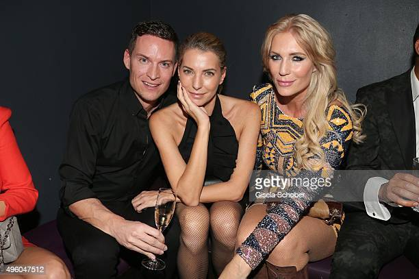 Giulia Siegel and her partner Frank Buechtmann and Sarah Kern during the opening of the night club Sam's on November 6 2015 in Munich Germany