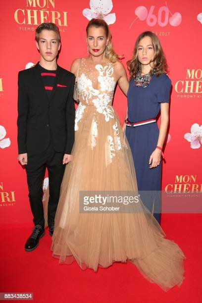 Giulia Siegel and her son Nathan and daughter Mia during the Mon Cheri Barbara Tag at Postpalast on November 30 2017 in Munich Germany