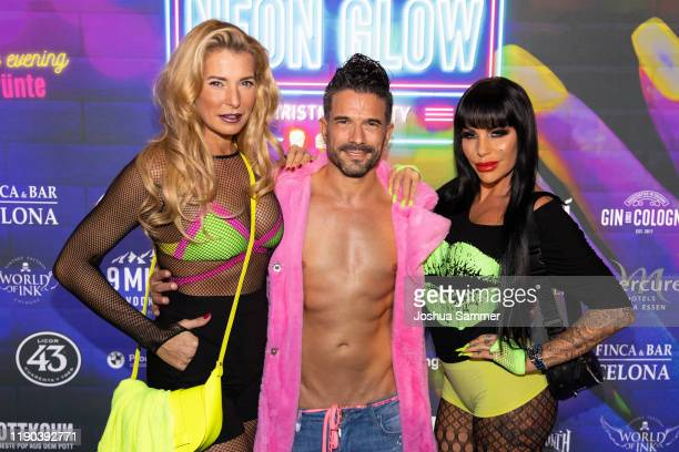 Giulia Siegel, Marc Terenzi and Gina Lisa Lohfink are seen during the McWonderland Neon Glow Christmas Party on November 25, 2019 in essen, Germany.