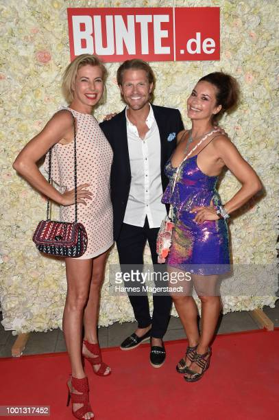 Giulia Siegel Paul Janke and Gitta Saxx during the 'Red Summer Night Of Bunte' at Bar Lehel on July 18 2018 in Munich Germany