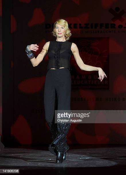 Giulia Siegel shows designs on the catwalk during the charity event Event Prominent at the Hotel Grand Elysee on March 25 2012 in Hamburg Germany