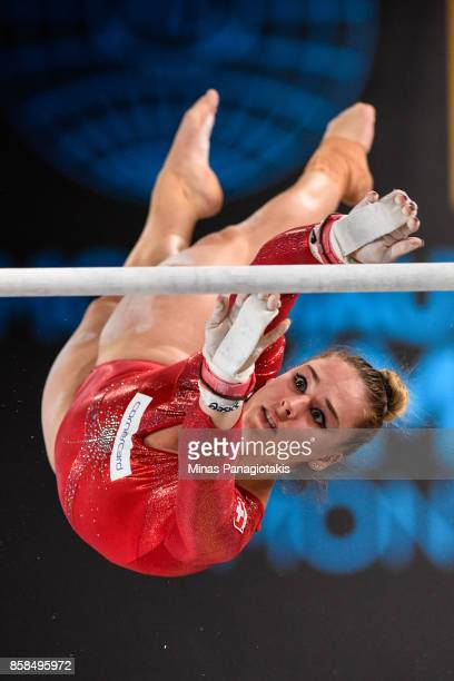 Giulia Steingruber of Switzerland competes on the uneven bars during the women's individual allaround final of the Artistic Gymnastics World...