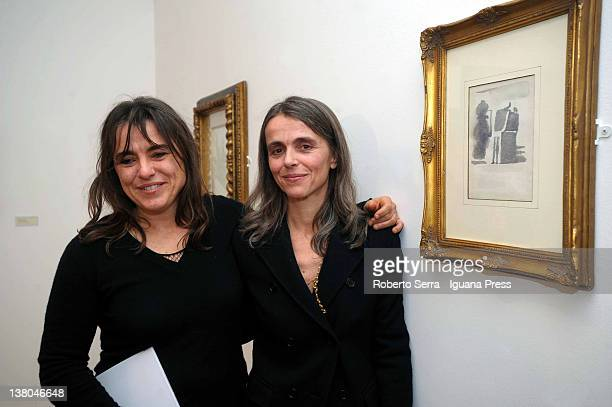 Giuliana and Cristina Pavarotti poses in front of one of their father Luciano's pictures at Morandi Museum on February 1, 2012 in Bologna, Italy....