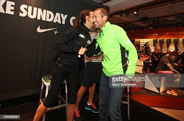 Giuliana Rancic and American longdistance runner Dathan Ritzenhein attend the Nike Run Club event at Nike Chicago on October 4 2012 in Chicago...