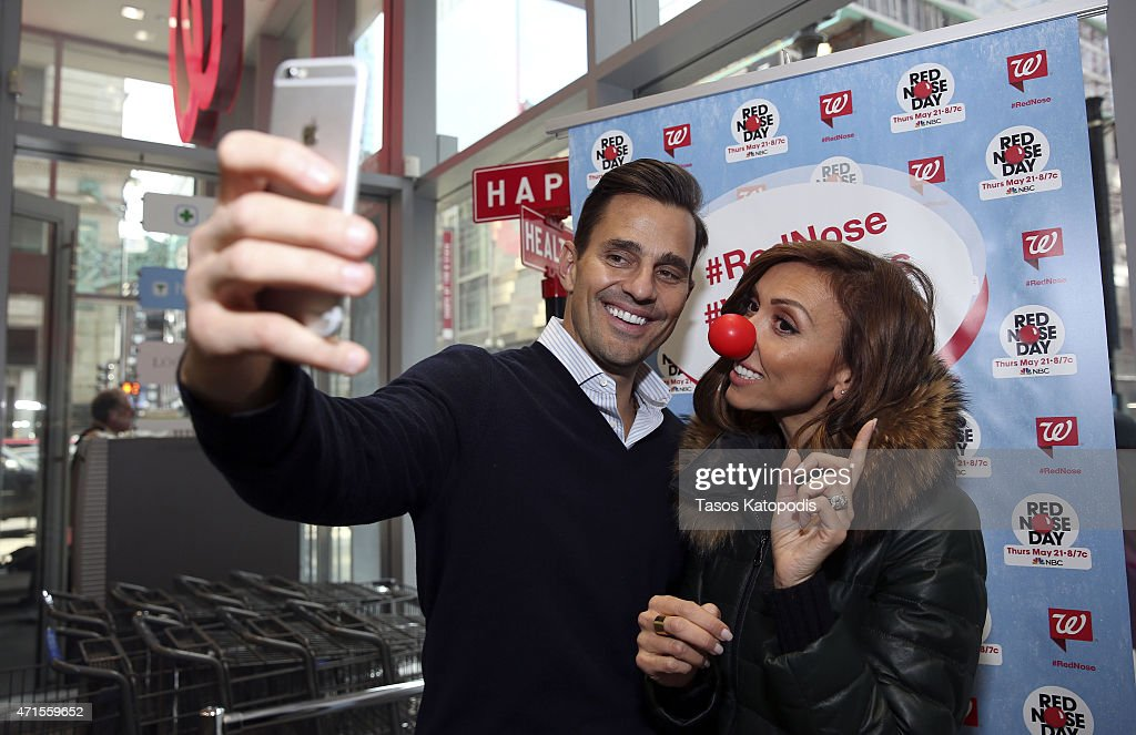 Giuliana Rancic and Bill Rancic share a laugh, don red noses, and join in on the Red Nose Day fun while visiting their local Walgreens April 22, 2015 in Chicago, Illinois.