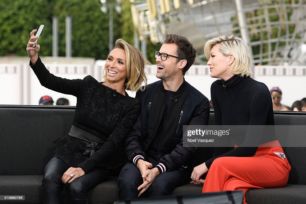 Giuliana Rancic, Brad Goreski and Charissa Thompson take a selfie at 'Extra' at Universal Studios Hollywood on February 17, 2016 in Universal City, California.