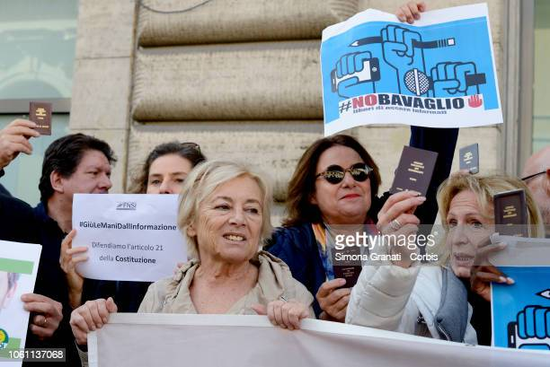 Giuliana Sgrena and ather Journalists show their professional cards and display signs saying 'a jackal lives here' during a flash mob to denounce...