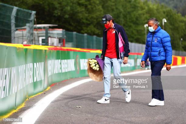 Giuliano Alesi of France and BWT HWA Racelab and his father, Jean Alesi, leave flowers at the side of the track in tribute to the late Anthoine...