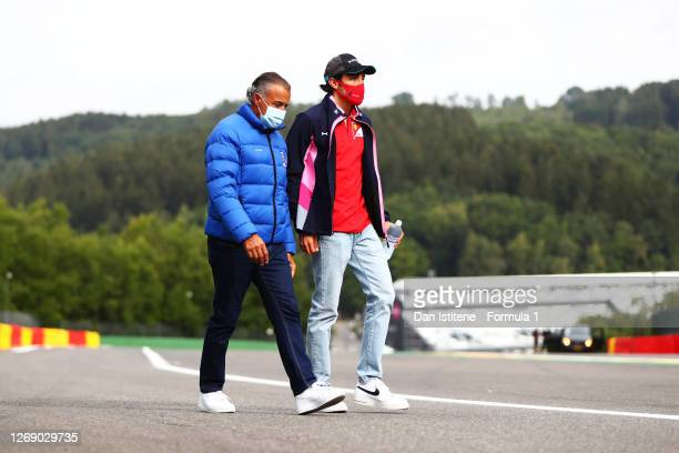 Giuliano Alesi of France and BWT HWA Racelab and is father, Jean Alesi, leave flowers at the side of the track in tribute to the late Anthoine...