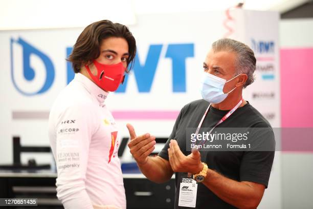 Giuliano Alesi of France and BWT HWA Racelab speaks with his father, Jean Alesi in the Paddock before qualifying for the Formula 2 Championship at...