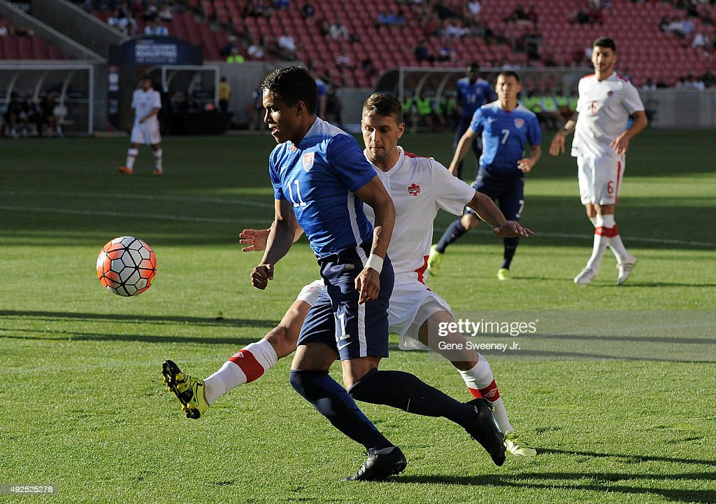 Giuliano Frano #3 of Canada directs the ball away from Alonso Hernadez #11 of the United States during the first half of the third place CONCACAF Olympic Qualifying match at Rio Tinto Stadium on October 13, 2015 in Sandy, Utah.