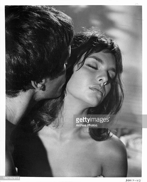 Giuliano Gemma kisses Rosemary Dexter in a scene from the film 'Blow Hot Blow Cold' 1969