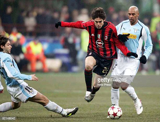 Giuliano Giannichedda and Ousmane Dabo of Lazio struggle for control of the ball against Kaka of AC Milan during the Italian Serie A football match...