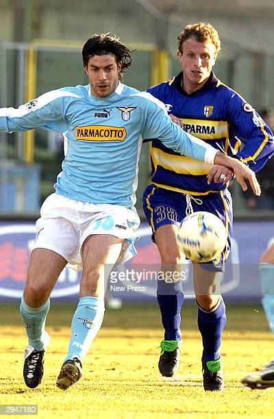 Giuliano Giannichedda of Lazio holds of a challenge from Fabrizio Cammarata during the Serie A match between Parma and Lazio at the Ennio Tardini...