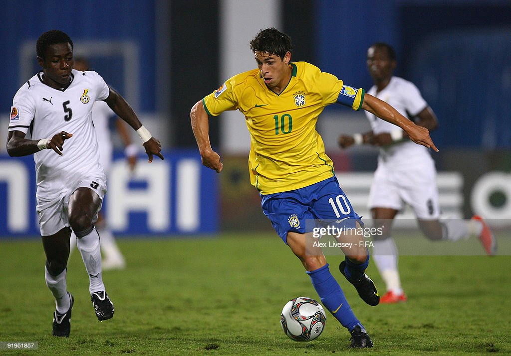 Giuliano of Brazil beats Daniel Addo of Ghana during the FIFA U20 World Cup Final between Ghana and Brazil at the Cairo International Stadium on October 16, 2009 in Cairo, Egypt.