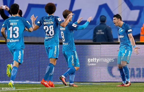 Giuliano of FC Zenit St Petersburg celebrates his goal with teammates during the Russian Football League match between FC Zenit St Petersburg and FC...