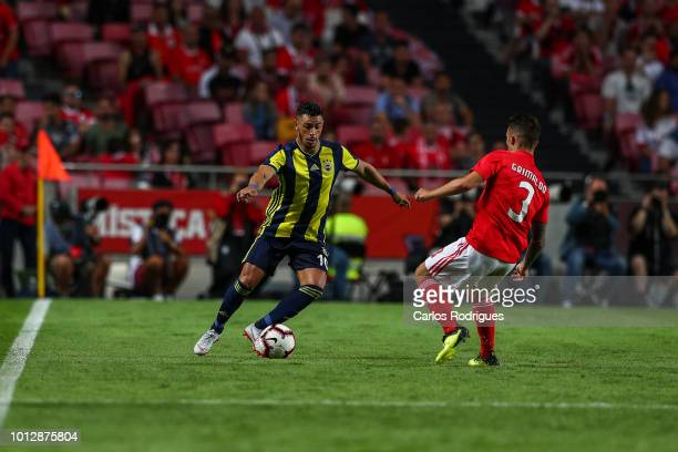 Giuliano of Fenerbache SK tries to escape Alex Grimaldo of SL Benfica during the match between SL Benfica and Fenerbache SK for UEFA Champions League...