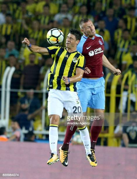 Giuliano of Fenerbahce in action against Jan Durica of Trabzonspor during Turkish Super Lig soccer match between Fenerbahce and Trabzonspor at the...