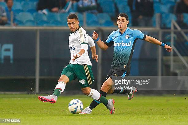 Giuliano of Gremio battles for the ball against Gabriel of Palmeiras during the match Gremio v Palmeiras as part of Brasileirao Series A 2015 at...
