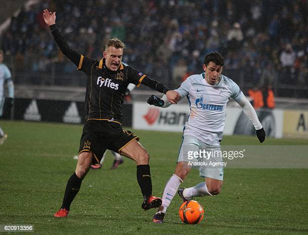 Giuliano of Zenit SaintPetersburg in action against Dean Shiels of Dundalk FC during UEFA Europa League match between Zenit StPetersburg and Dundalk...