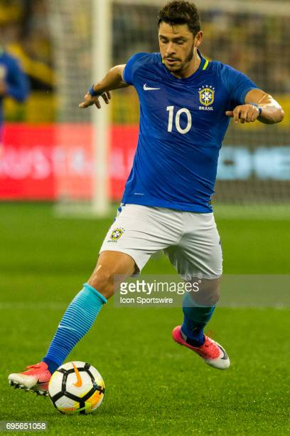Giuliano Paua of the Brazilian National Football Team runs with the ball during the International Friendly Match Between Brazilian National Football...