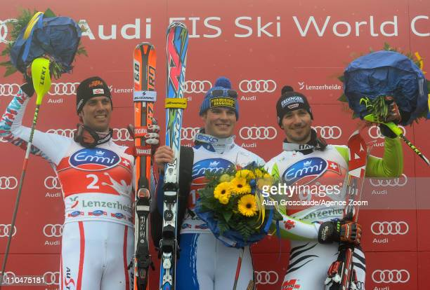 Giuliano Razzoli of Italy takes 1st place Mario Matt of Austria takes 2nd place Felix Neureuther of Germany takes 3rd place during the Audi FIS...