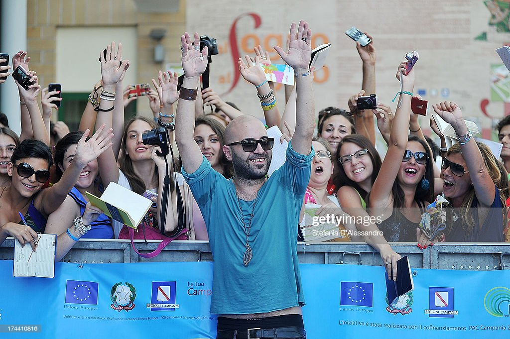 Giuliano Sangiorgi of Negramaro poses with fans at the 2013 Giffoni Film Festival blue carpet on July 25, 2013 in Giffoni Valle Piana, Italy.