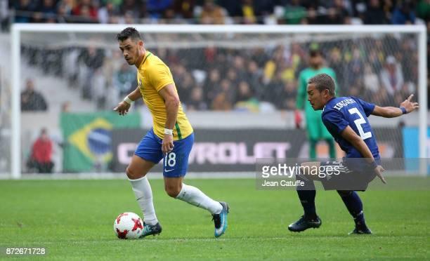 Giuliano Victor de Paula of Brazil Yosuke Ideguchi of Japan during the international friendly match between Japan and Brazil at Stade Pierre Mauroy...